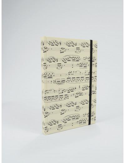 Notebook sheet music creme...